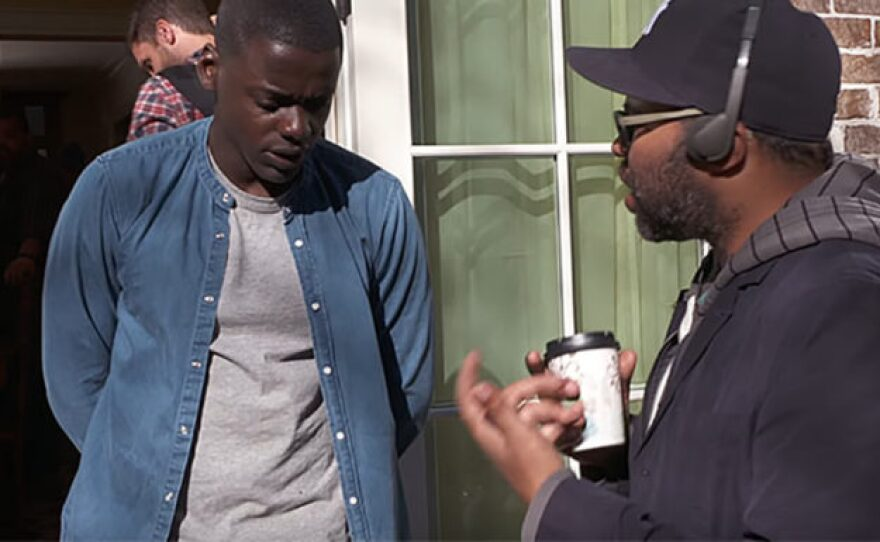 """Actor Daniel Kaluuya takes direction from Jordan Peele on the set of """"Get Out."""""""