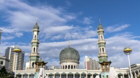 The Dongguan Great Mosque in Xining, China, photographed in 2018. Its main green dome and minaret domes have since been removed.