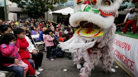 In this Jan. 21, 2006, file photo, Chinese lion dancers perform in Oakland's Chinatown in Oakland, Calif.