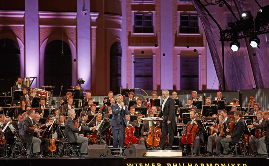 Enjoy the Vienna Philharmonic Orchestra's performance of selections by Strauss, Wagner, Offenbach, Puccini and more from the Schönbrunn Palace Gardens under the baton of conductor Valery Gergiev featuring Metropolitan Opera tenor Jonas Kaufmann.
