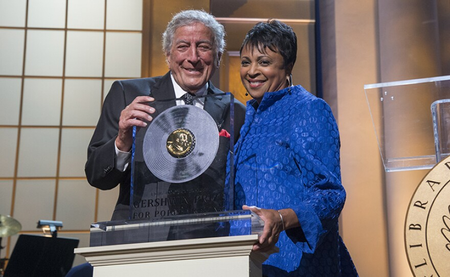 Honoree Tony Bennett with Librarian of Congress Carla Hayden as she presents the Library of Congress Gershwin Prize for Popular Song.