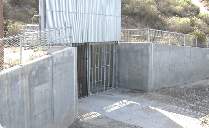 A metal grate in Smuggler's Gulch allows to flow between the U.S. and Mexico, Dec. 2, 2015.