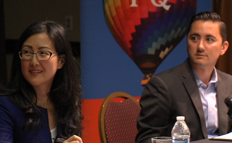 Carol Kim and Chris Cate look at the moderator at a district 6 city council candidate forum in Rancho Peñasquitos, Oct. 15, 2014.