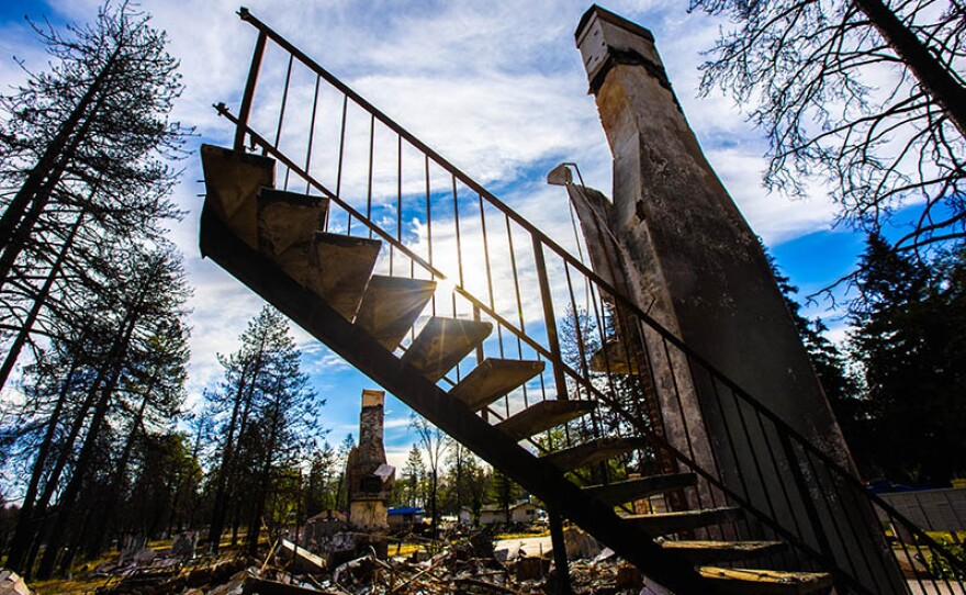 Part of a stairway still standing in the burned remains from a house in Paradise, Calif.
