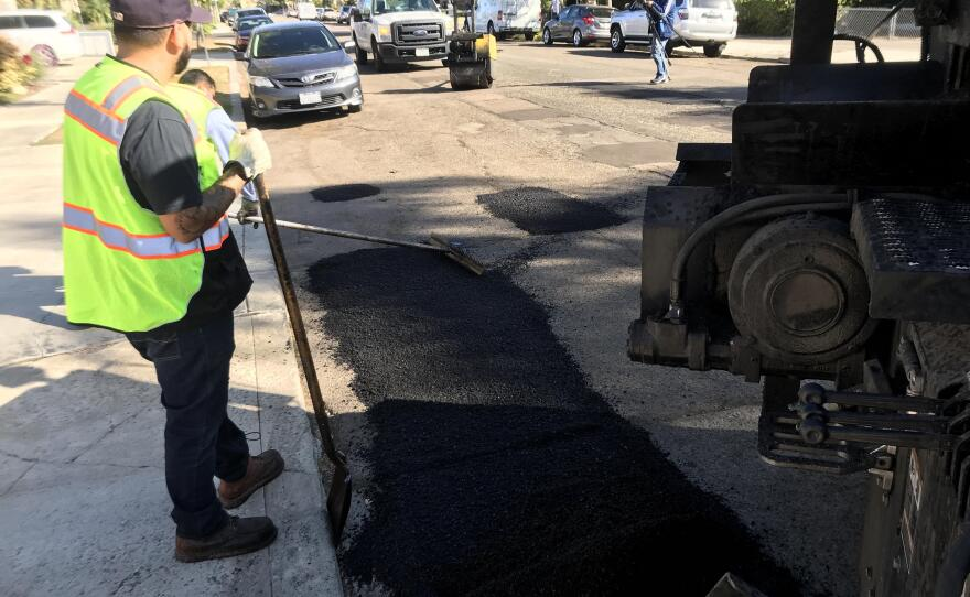 City employees filling a pothole in the University Heights neighborhood on Oct. 2, 2019.