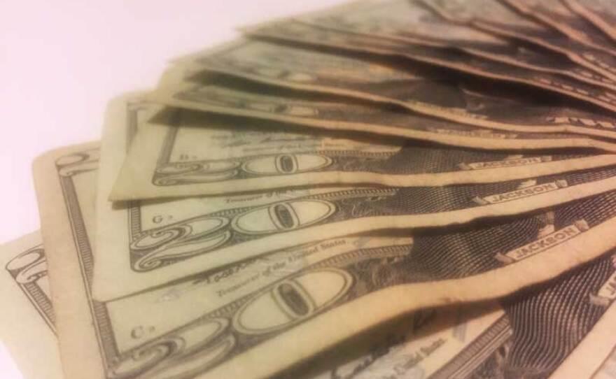 Twenty dollar bills are shown in this photo, Aug. 23, 2017.