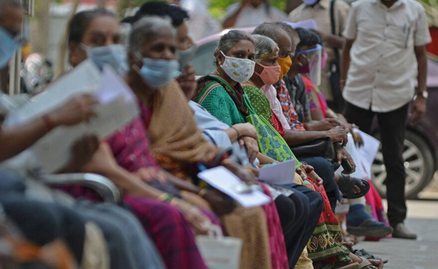 People wait their turn to receive the COVID-19 vaccine at a government hospital in Chennai, India, in April. India is among the nations which will receive surplus U.S. vaccine through the international distribution system COVAX, the White House announced.