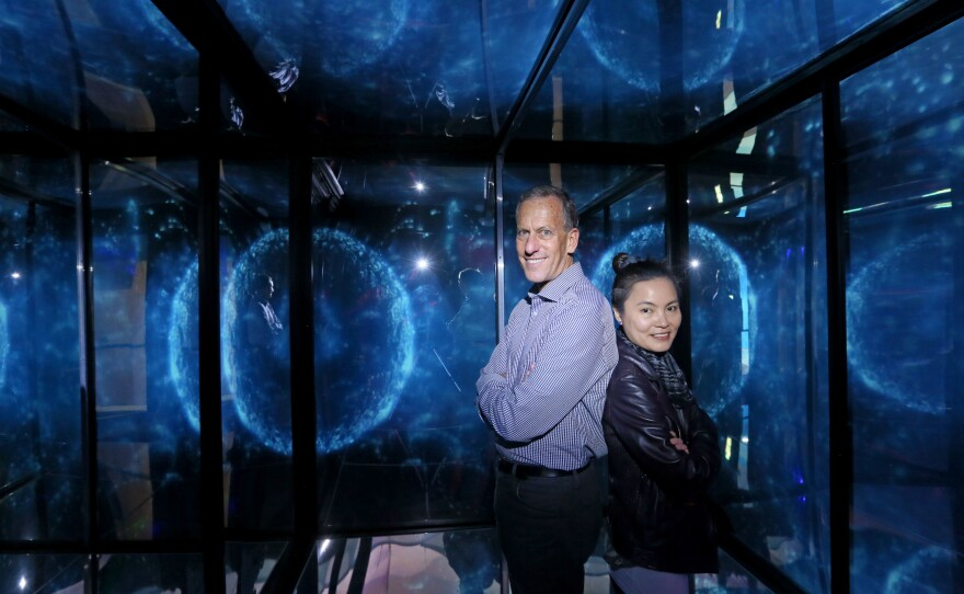 Scripps Institution of Oceanography marine biologist Michael Latz (left) with artist Ivyone Khoo in an undated photo. Khoo worked with Latz to film bioluminescent creatures for her Infinity Cube exhibit at the Birch Aquarium.