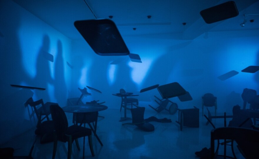 """The scene depicted in the immersive installation piece """"Mother the Air is Blue, the Air is Dangerous"""" part of Tim Shaw: Beyond Reason exhibit at San Diego Museum of Art."""