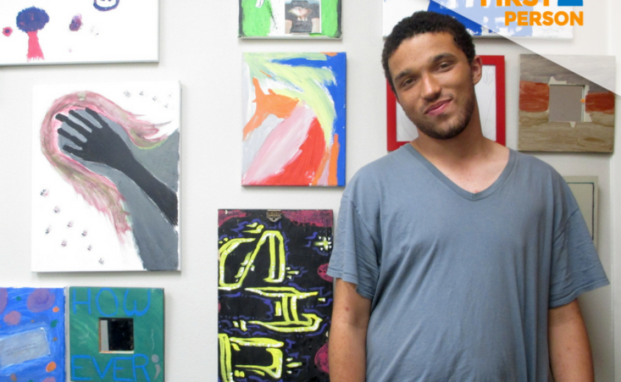 David McConnell is pictured at the Sherman Heights location of Urban Beats in front of a wall of artwork, July 20, 2018.