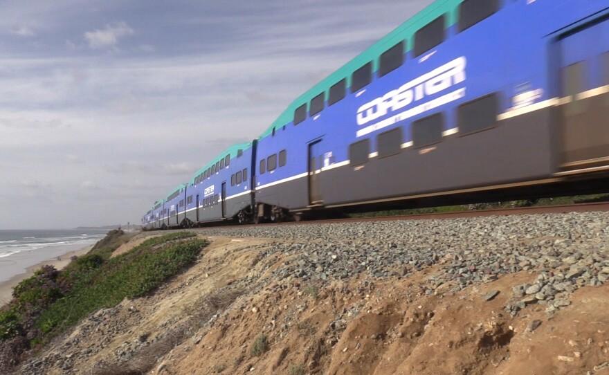 A Coaster train running through a neighborhood in Del Mar, April 14, 2021.