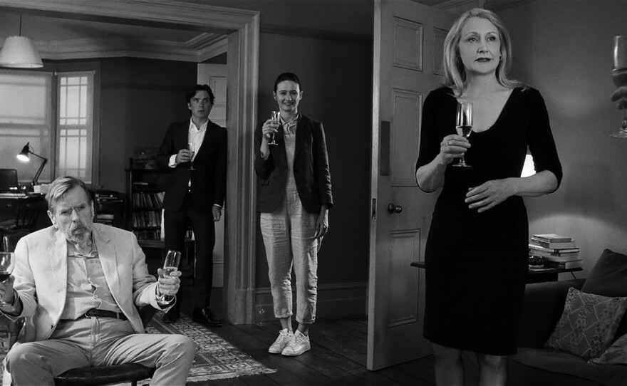 """April (Patricia Clarkson, far right) makes a toast to her host while Bill (Timothy Spall), Tom (Cillian Murphy) and Jinny (Emily Mortimer) listen in Sally Potter's """"The Party."""""""