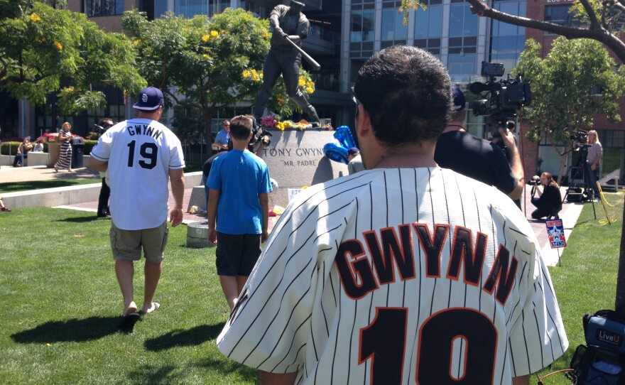 Fans pay tribute to Tony Gwynn near his statue at Petco Park, June 16, 2014.