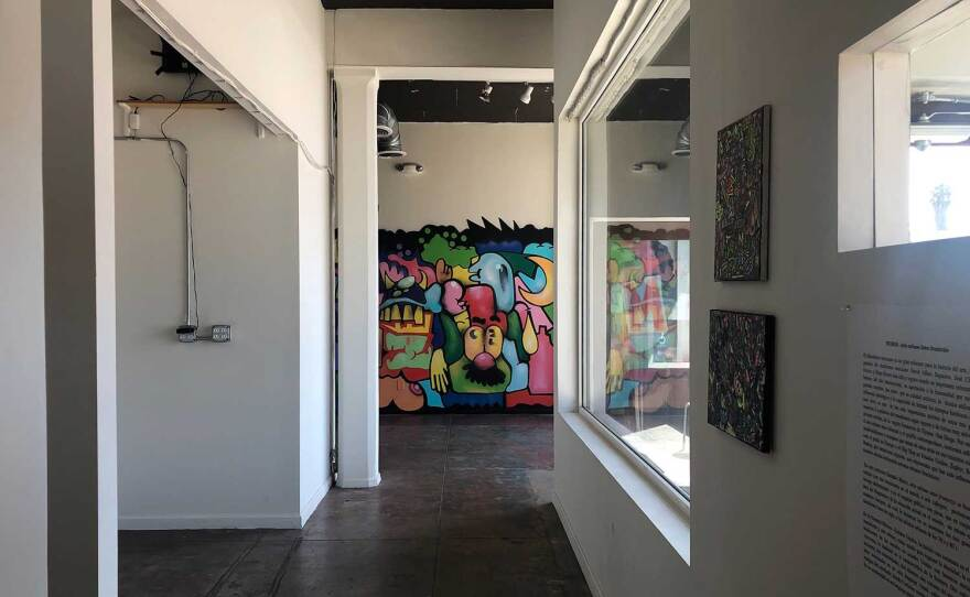 An interior exhibition at The Front gallery features smaller works and an indoor mural by muralist Juan Carlos Galindo (GRVR), pictured on September 25, 2020.