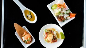 BlueNalu's whole-muscle, cell-based yellowtail prepared in four different recipes (clockwise from top left): roasted butternut squash & yellowtail bisque, poke bowl, fish taco, and kimchi, in an undated photo.