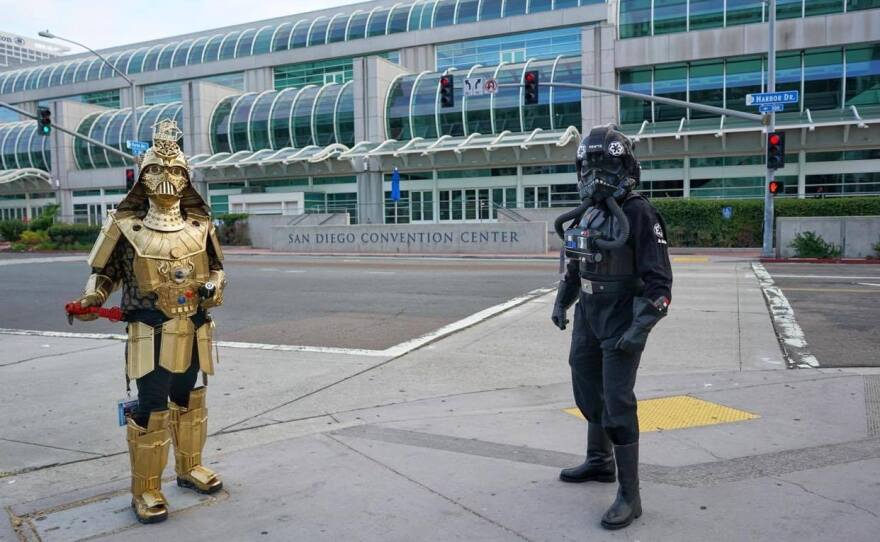 Dude Vader (Christopher Canole) and a TIE Fighter pilot (Todd Felton) welcomed people to the empty San Diego Convention Center on Wednesday. Comic-Con would have started that day if the coronavirus had not forced the pop culture convention to move online.