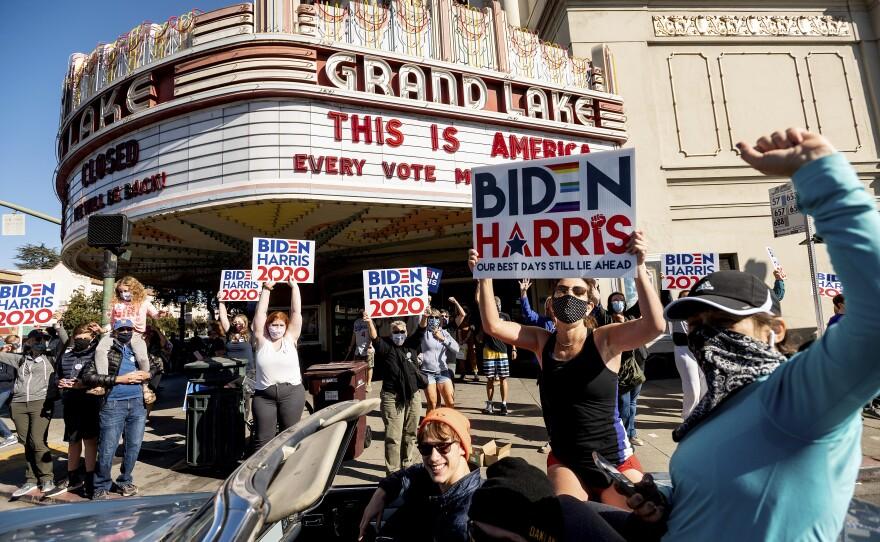 People celebrate the victory of President-elect Joe Biden and Vice President-elect Kamala Harris in Oakland, Calif., on Saturday, Nov. 7, 2020.