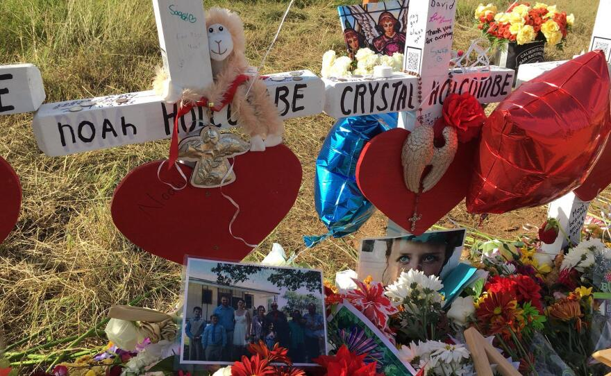 Flowers and photos decorate a memorial for members of the Holcombe family, which lost nine members in a church shooting in Sutherland Springs, Texas, in this undated photo.
