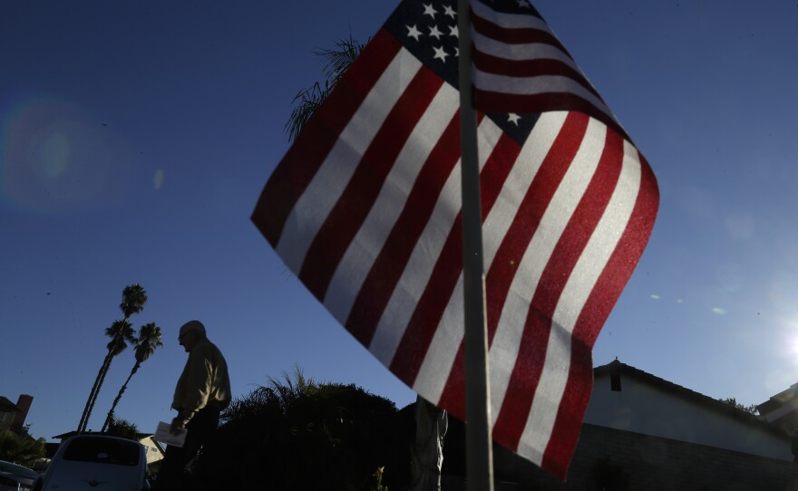 A voter leaves a polling station after casting his ballot in San Diego, Nov. 4, 2014.