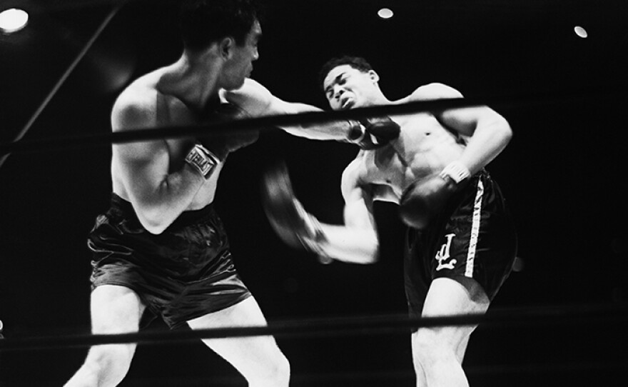 In their first meeting at Yankee Stadium in 1936, Max Schmeling lands a left to the face of Joe Louis during their bout for the World Heavyweight Championship. Schmeling's ultimate victory would thrust him into the awkward role of a Nazi propaganda symbol.