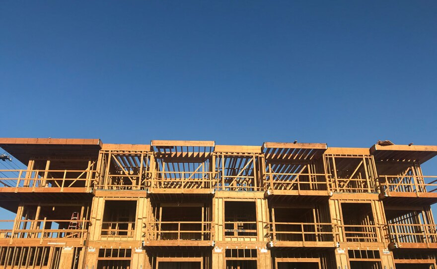 The wood framing of a new apartment building goes up in North Park, Sept. 23, 2019.