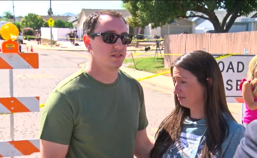 Cody and Courtney Campbell outside their home that was gutted when a Cessna A340 plane crashed into it, Oct. 12, 2021.