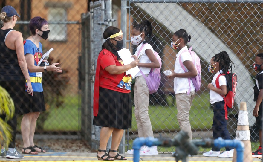 Students return to school at Seminole Heights Elementary School after the Florida Department of Education mandated that all schools must have in-class learning during the week on August 31, 2020 in Tampa, Florida.