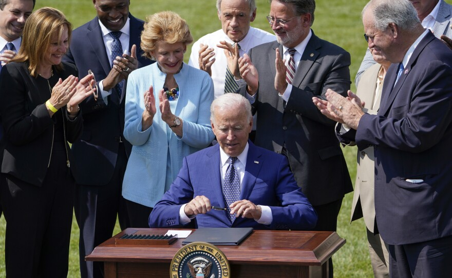 President Joe Biden signs an executive order on increasing production of electric vehicles after speaking on the South Lawn of the White House in Washington, Thursday, Aug. 5, 2021, during an event on clean cars and trucks.