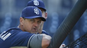 Former San Diego Padres closer Trevor Hoffman leans on the batting cage before a baseball game against the Houston Astros, April 27, 2015.