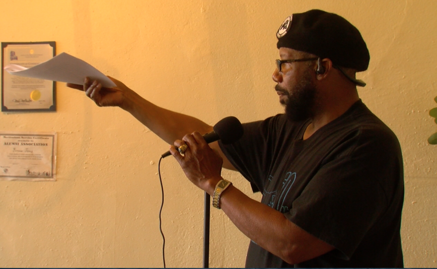 San Diego Black Panther Party Chairman Henry Wallace recites the group's 10-point platform at recent meeting, February 18, 2017.