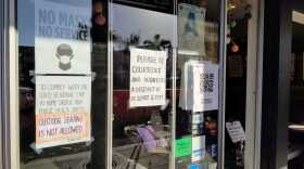 Signs outside the Plumeria Vegetarian Restaurant in Encinitas advising patrons that masks are required inside the establishment, Jan. 2, 2021.