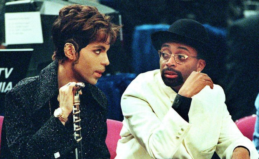 Filmmaker Spike Lee (right) talks with Prince during the NBA All-Star Game at Madison Square Garden in 1998.