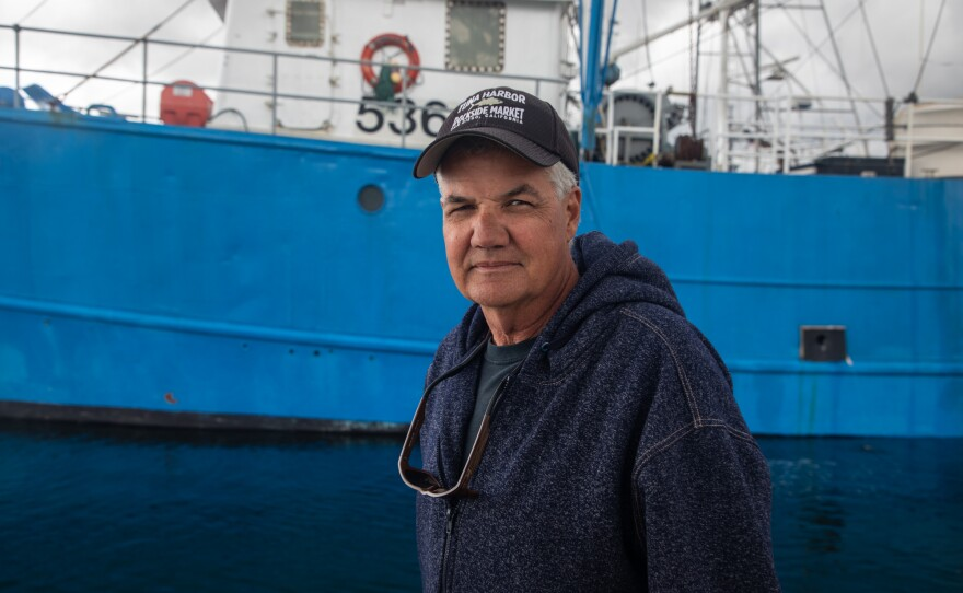 Commercial fisherman David Haworth stands on a dock in San Diego's Tuna Harbor, March 18, 2020. Haworth is exploring ways to sell fish directly to consumers as his restaurant market has shut down in the wake of the COVID-19 outbreak.