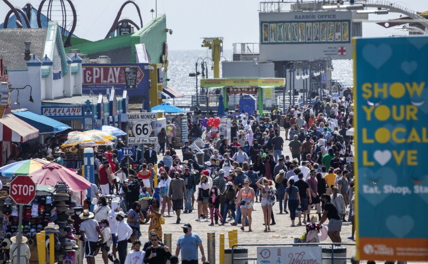 The Santa Monica Pier welcomed outdoor visitors on Monday as Los Angeles County entered the less restrictive orange tier. The following day, California Gov. Gavin Newsom announced a target statewide reopening date of June 15, provided certain public health criteria are met.