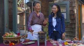 Su-Mei Yu cooking a Thai version of yakitori with Erika Shiraishi from the Japan Society of San Diego.