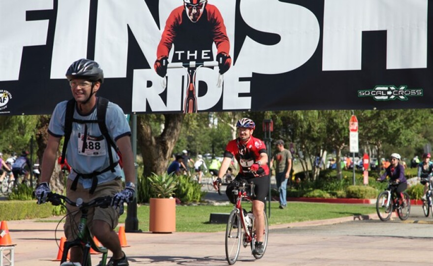 Damian Kevitt rolls through the finish line a year after a horrific hit-and-run crash that resulted in him losing a leg.