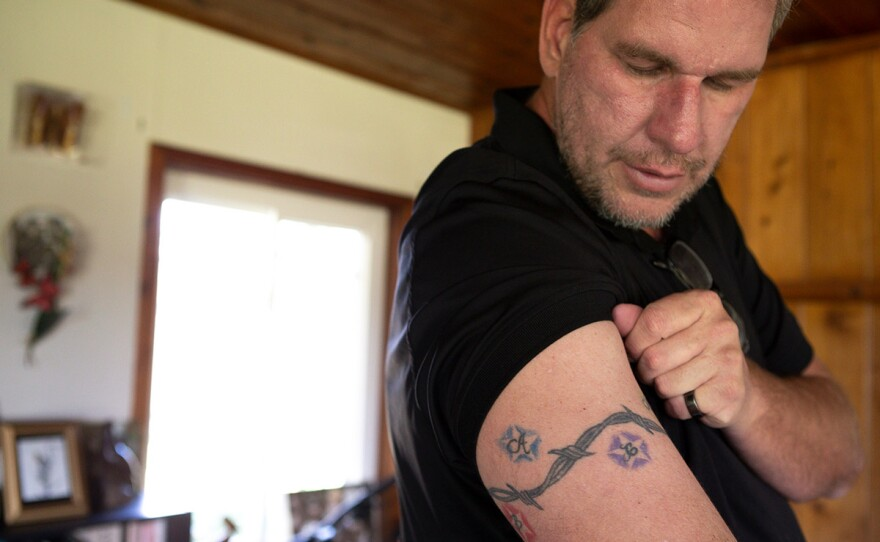 Andrew Simmons showing the tattooed the initials of all six of his adopted children on his arm in this photo taken Jan. 30, 2020. Simmons still owes San Diego County over $13,000 for the time his son spent in juvenile hall as a teen.