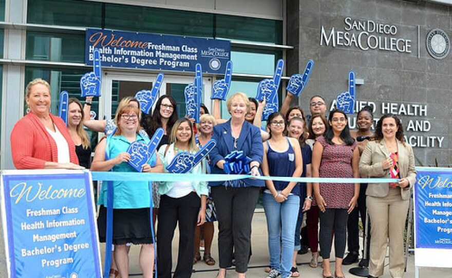 Mesa College students and administrators celebrate the opening of the school's first bachelor's degree program in this undated photo.