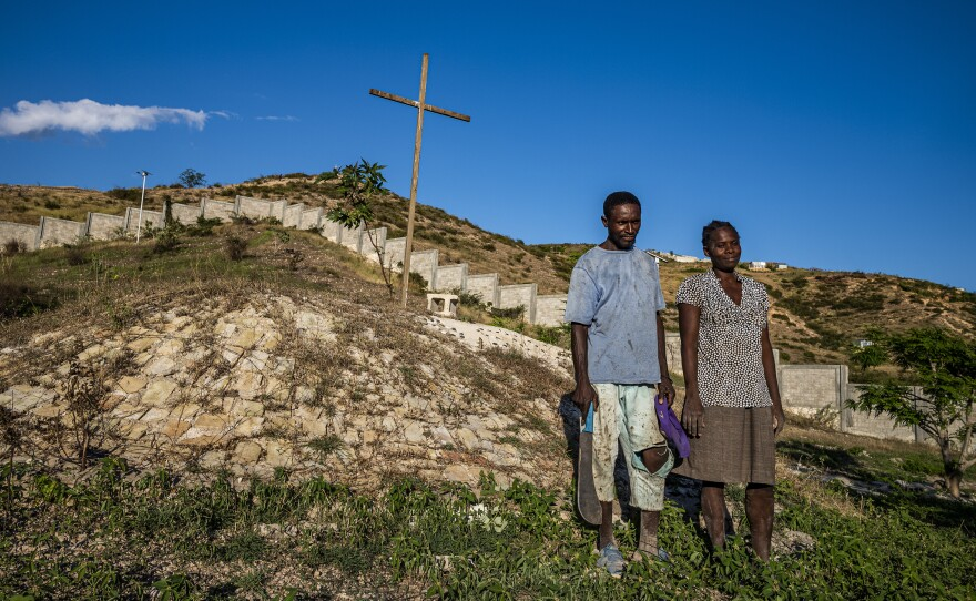 Duenet Alexand (left) and Berthenid Dasny have been maintaining the grounds at the St. Christophe memorial at Titanyen, north of Port-au-Prince, where thousands of earthquake victims were buried in mass graves.