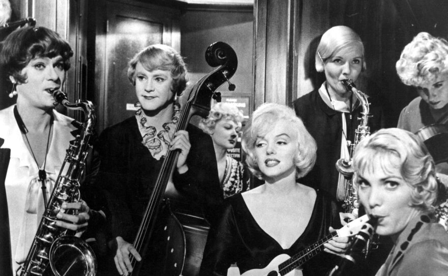 """Tony Curtis and Jack Lemmon play musicians who have to dress like women to join an all-girl band to escape from mobsters. Marilyn Monroe co-stars in Billy Wilder's """"Some Like It Hot."""""""