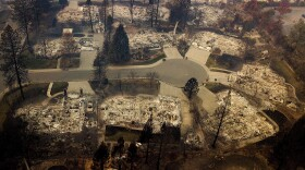 Residences leveled by the Camp Fire line a cul-de-sac in Paradise, Calif., Nov. 2018.