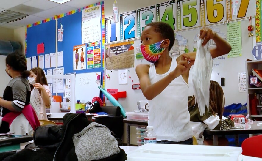 A student at Bostonia Elementary school part of the at Bostonia Language Academy in El Cajon wears a face covering, March 19, 2021.