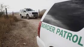 U.S. Border Patrol vehicles travel through the Arizona desert about 10 miles north of Mexico, Dec. 16, 2010.