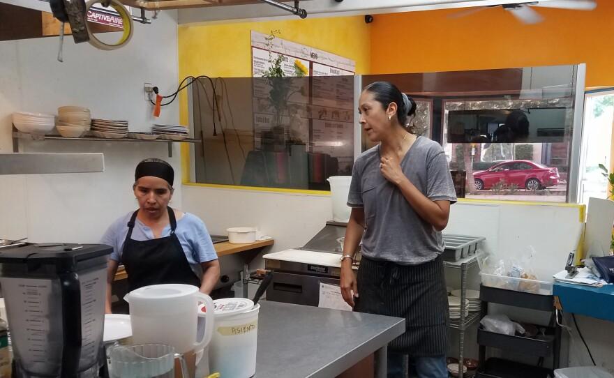 Rodnia Attiq works in the kitchen of her restaurant El Borrego, Oct. 3, 2018.
