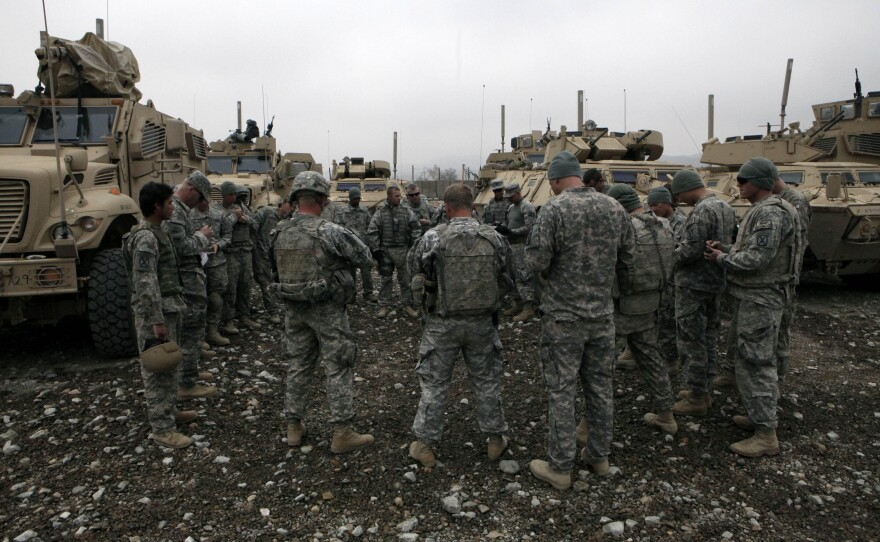 U.S. Army soldiers belonging to the 1st Platoon, Able Troop 3-71 Cavalry Squadron and members of the South Carolina National Guard, hold a briefing before boarding their vehicles at the Joint Command Outpost near the town of Baraki Barak, Logar province, Afghanistan Tuesday, Nov. 24, 2009.