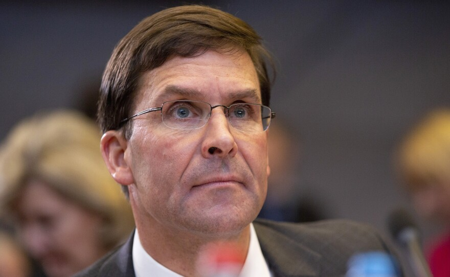 Defense Secretary Mark Esper, pictured in October, told reporters at the Defense Department on Monday that President Trump ordered him to ensure that Eddie Gallagher retained his Navy SEAL Trident pin.