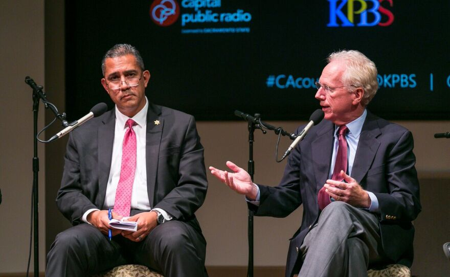 Association of Orange County Deputy Sheriffs President Tom Dominguez, left, and former San Diego County District Attorney Paul Pfingst, sit at a panel during a death penalty town hall at the University of San Diego, Sept. 8, 2016.