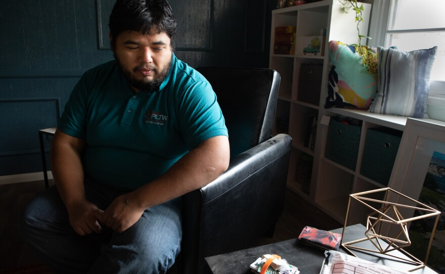 Jorge Gomez looks through his brother Jose Angel Gomez-Camacho's possessions, Feb. 13, 2020. His brother died by suicide while isolating at the Crowne Plaza hotel in Mission Valley after testing positive for COVID-19.