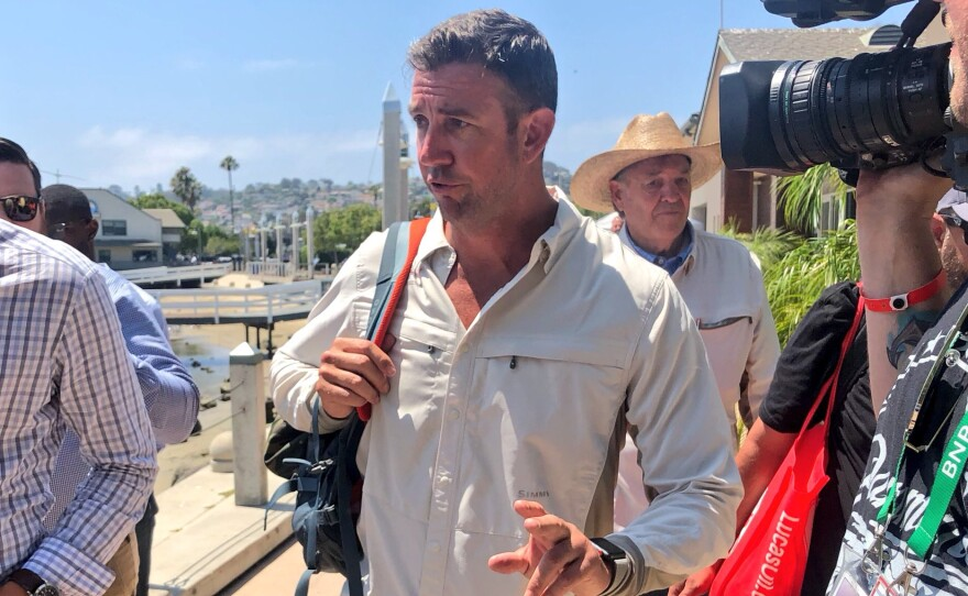 Rep. Duncan Hunter, R-Alpine, speak with reporters in Point Loma after a fishing trip for wounded veterans, Aug. 22, 2018.