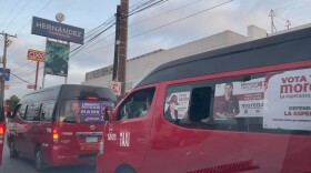 Campaign posters for the 2021 Mexican election on the windows of Tijuana taxis. May 14, 2021.